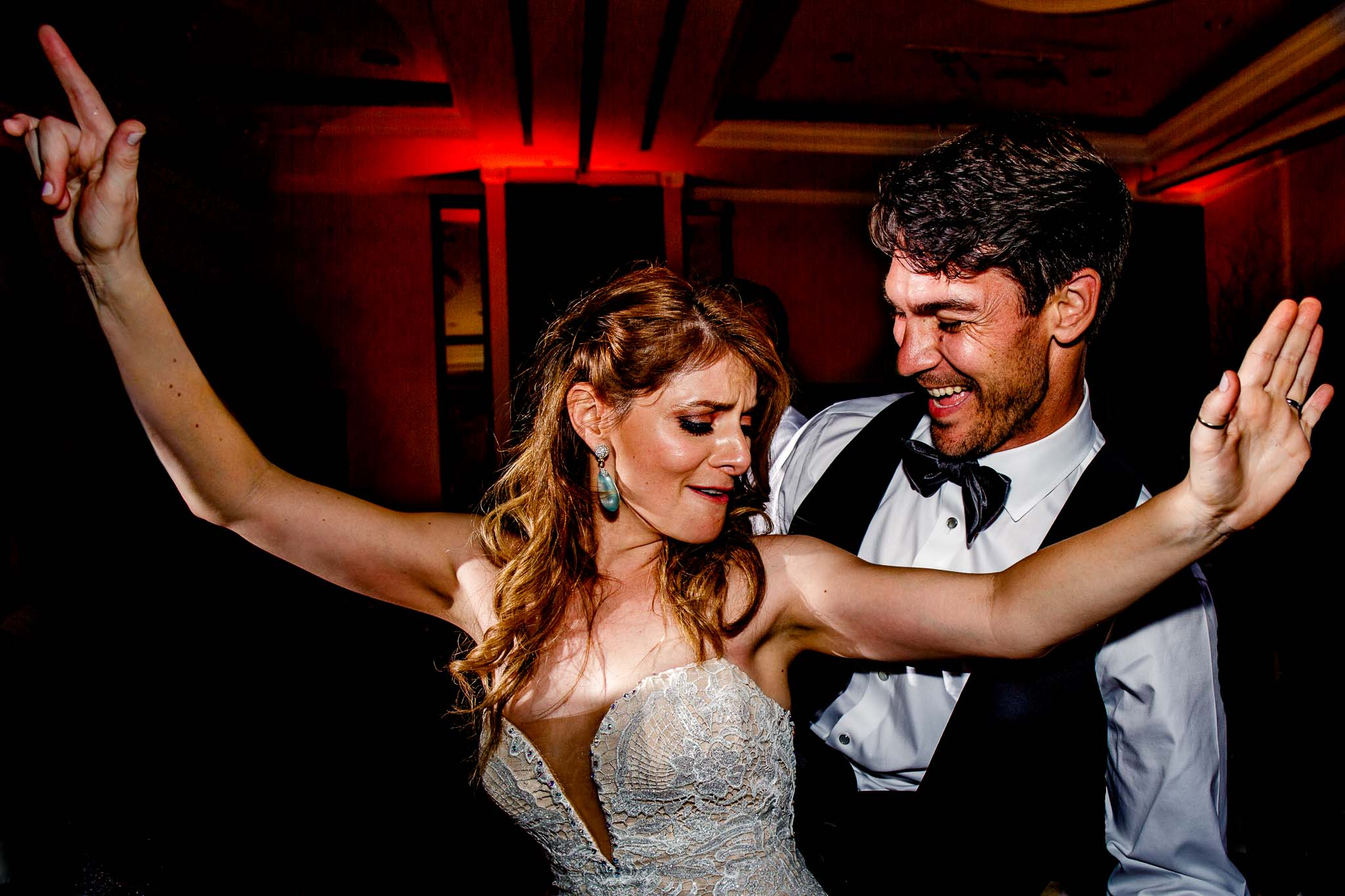 Bride and Groom dancing crazy on reception dance floor in Peru