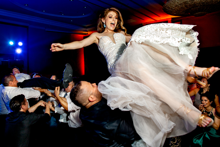 Peru wedding bride flying in air at reception