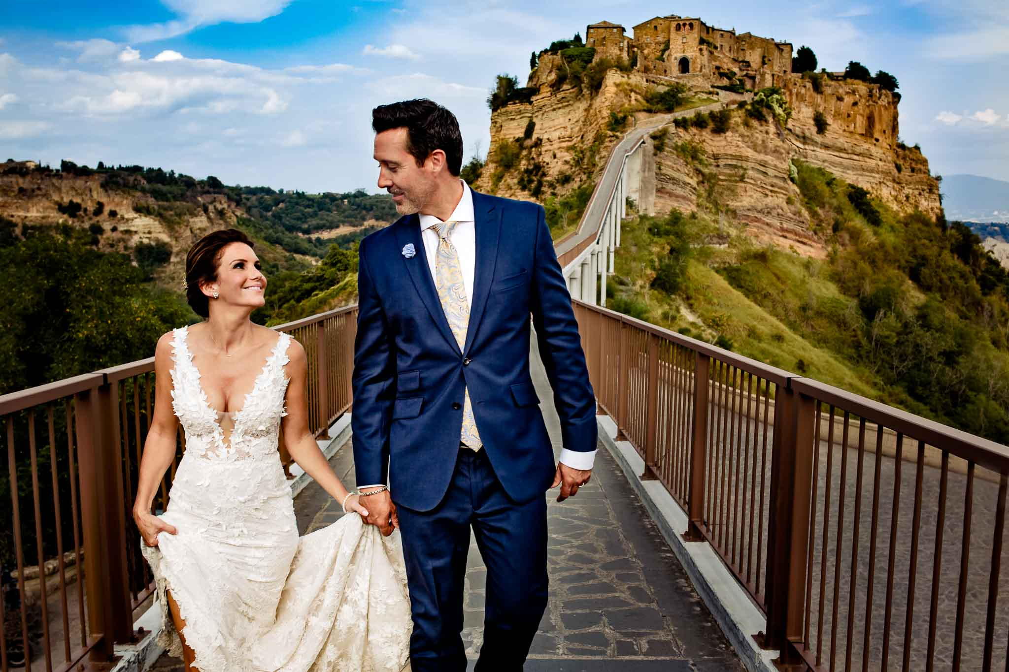 Bride and groom walking in Italy at Civita de Bagnoregio