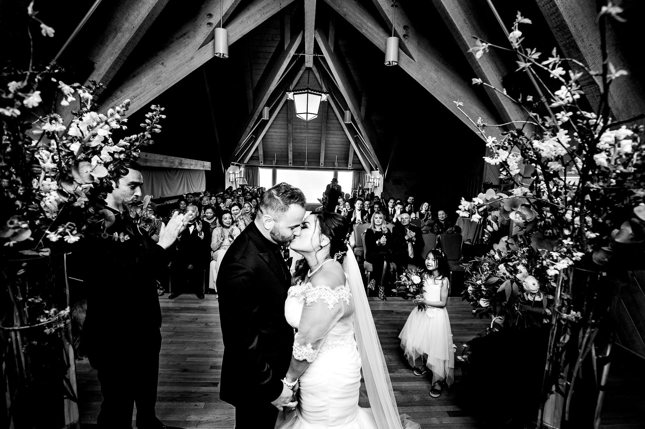 Bride and groom kissing during their ravens nest wedding ceremony