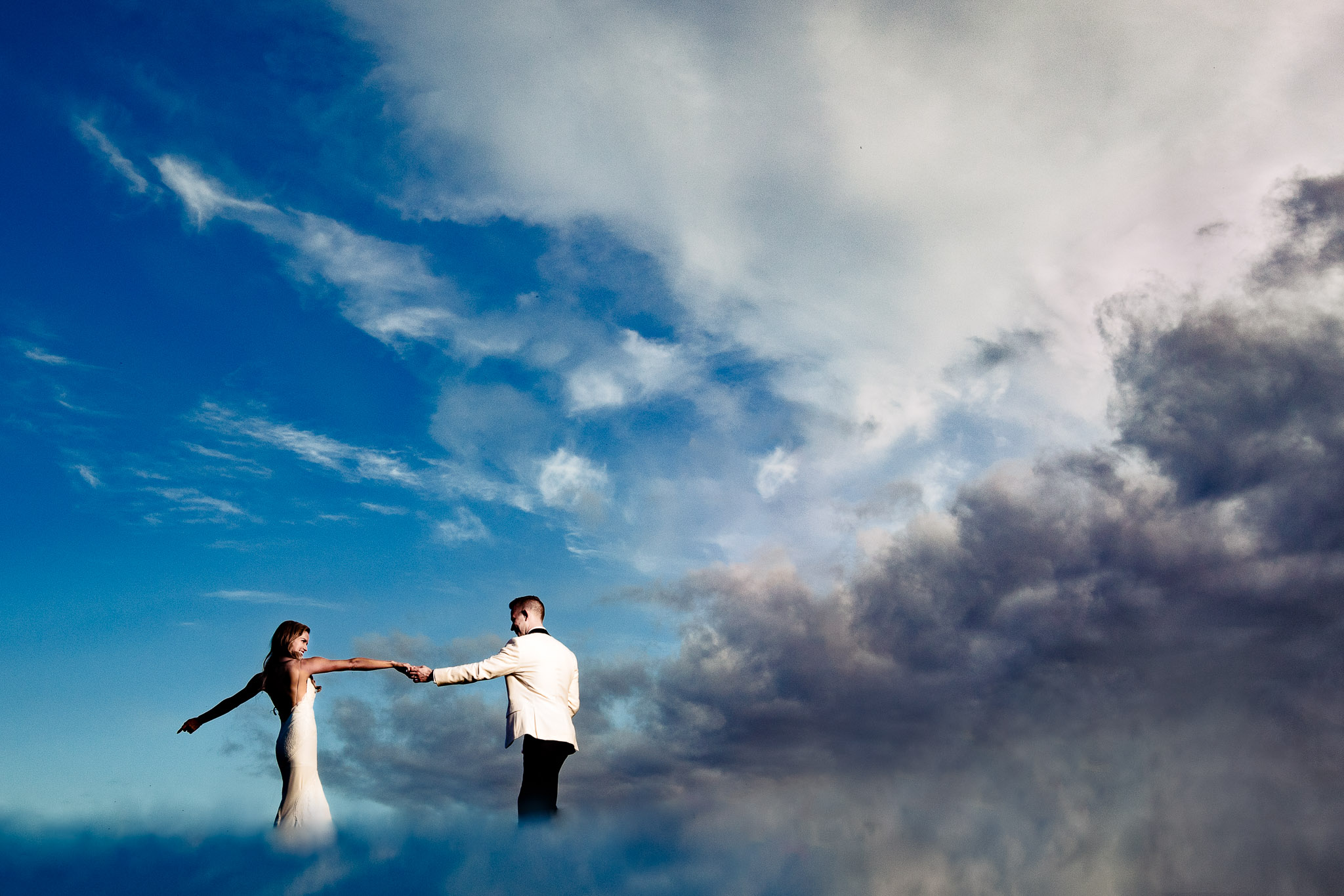 Gorgeous photo of Bride and Groom dancing in infinite clouds at Youngberg Hill Winery