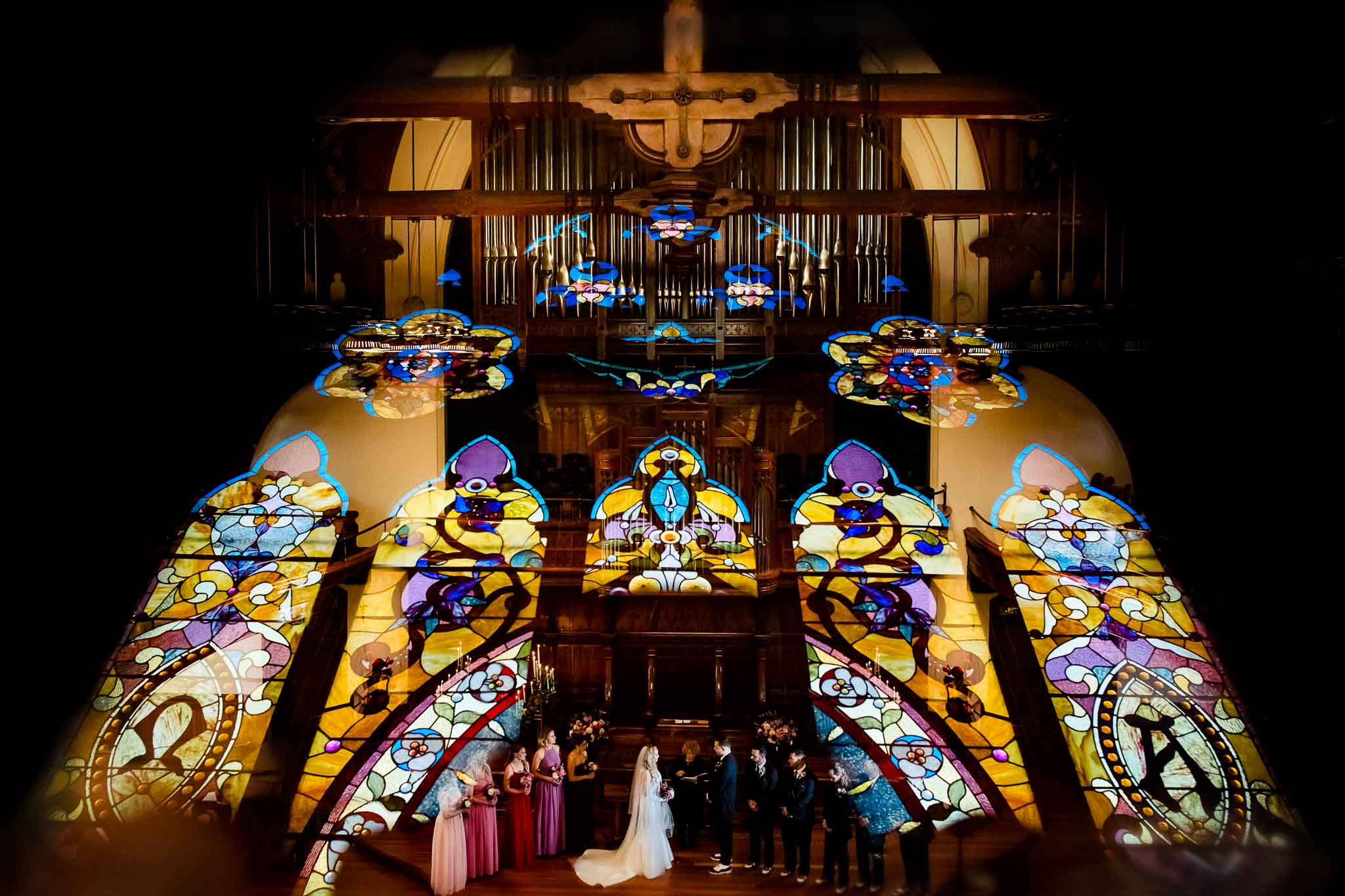 Stainglass reflection over cathedral ceremony in Portland Oregon