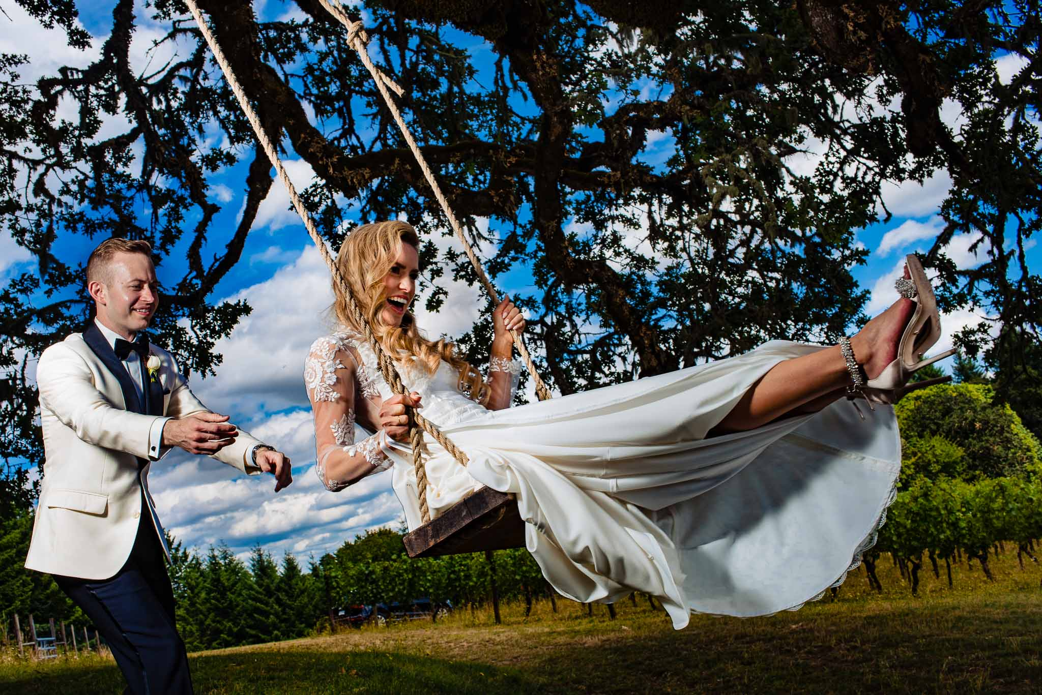 Bride swinging with Groom at Youngberg Hill Winery on their wedding day