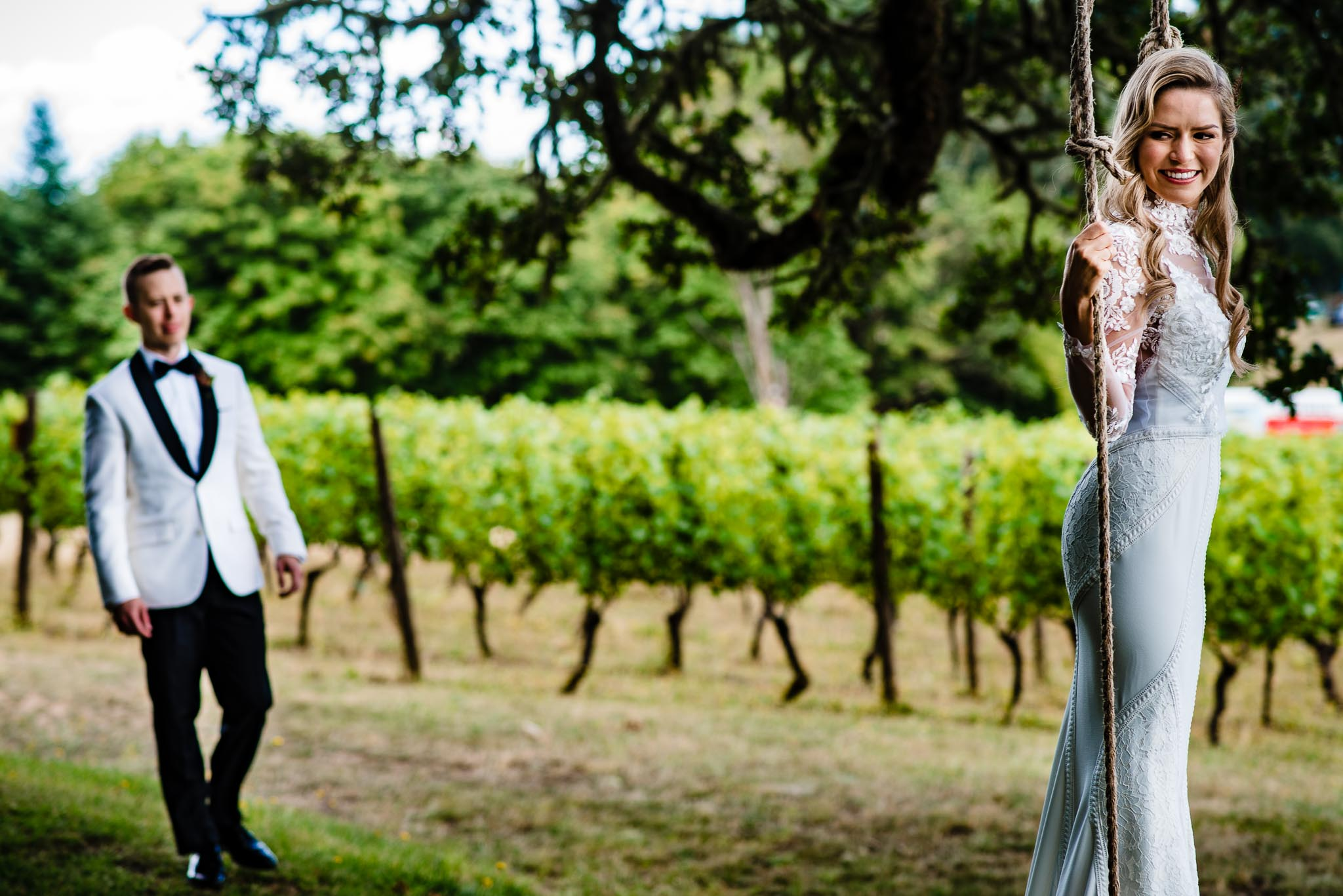 Bride and Groom on swing at Youngberg Hill Winery on their wedding day