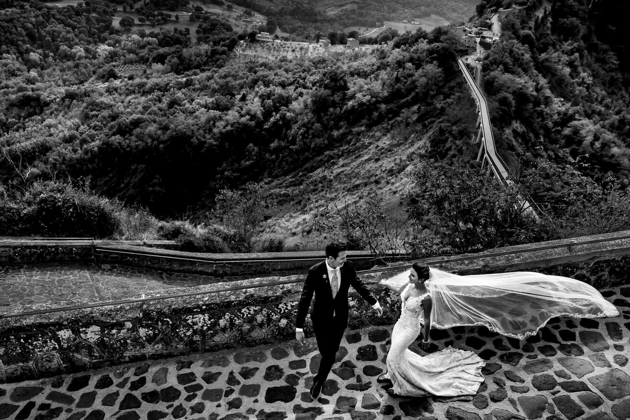 Bride and Groom walking in Civita di Bagnoregio Italy
