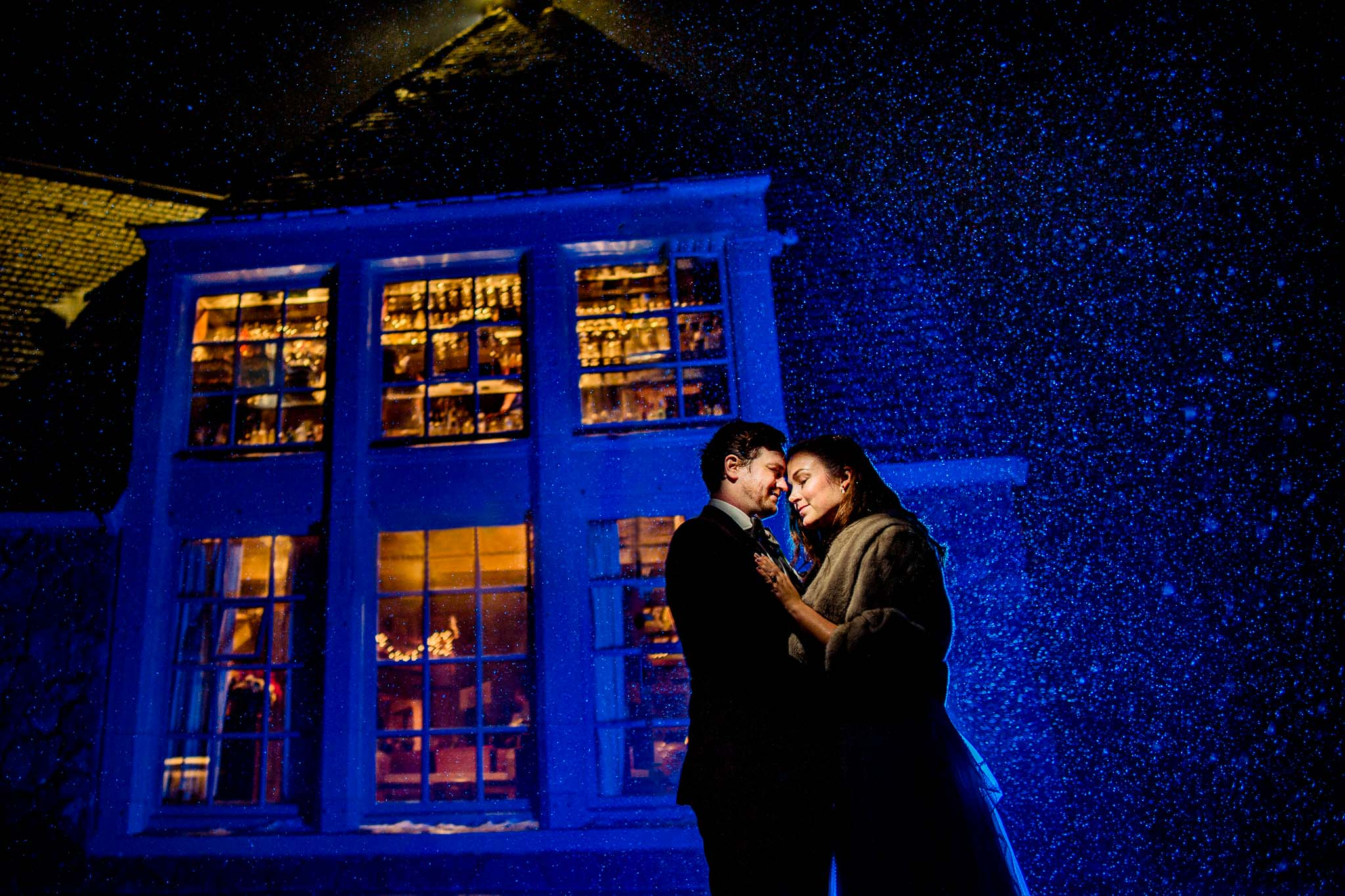 Bride and Groom creatively lit in snow at Timberline Lodge for their winter wedding