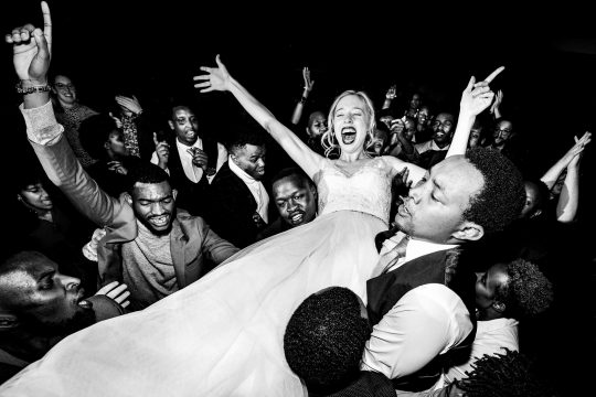 Bride flying high on dance floor at Timberline Lodge Ski Resort